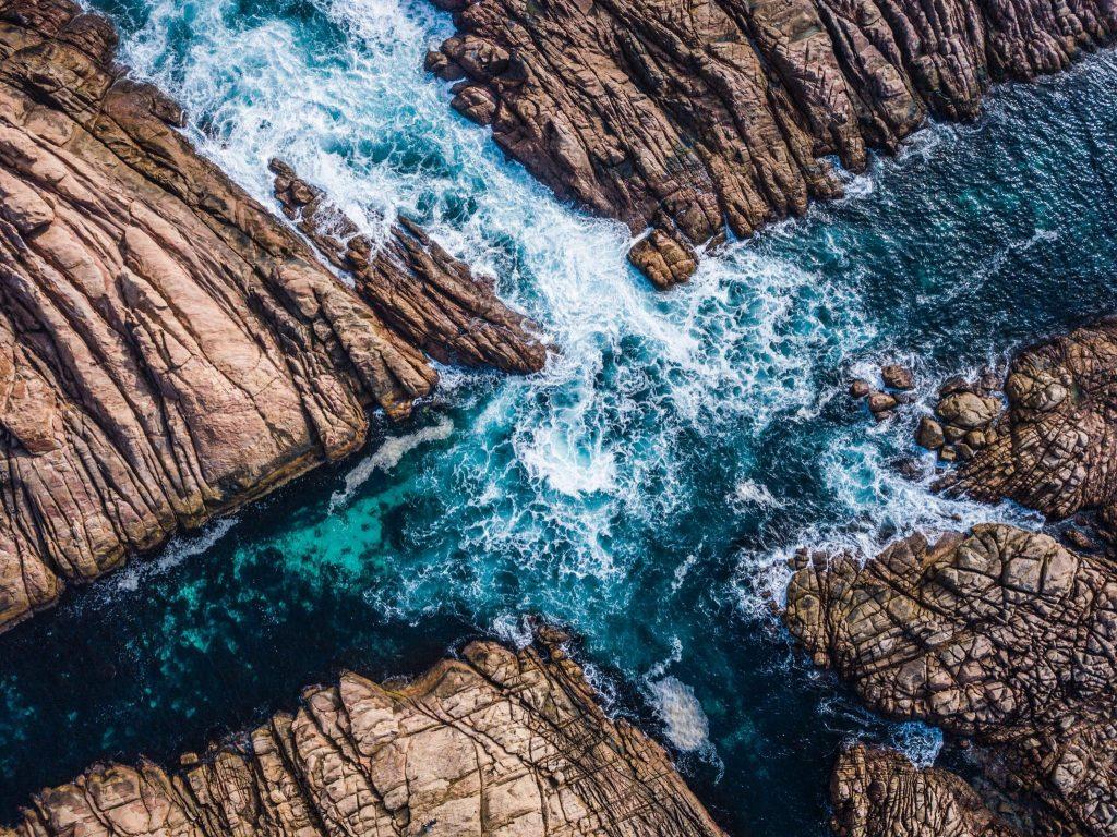 Streams coming together between rocks